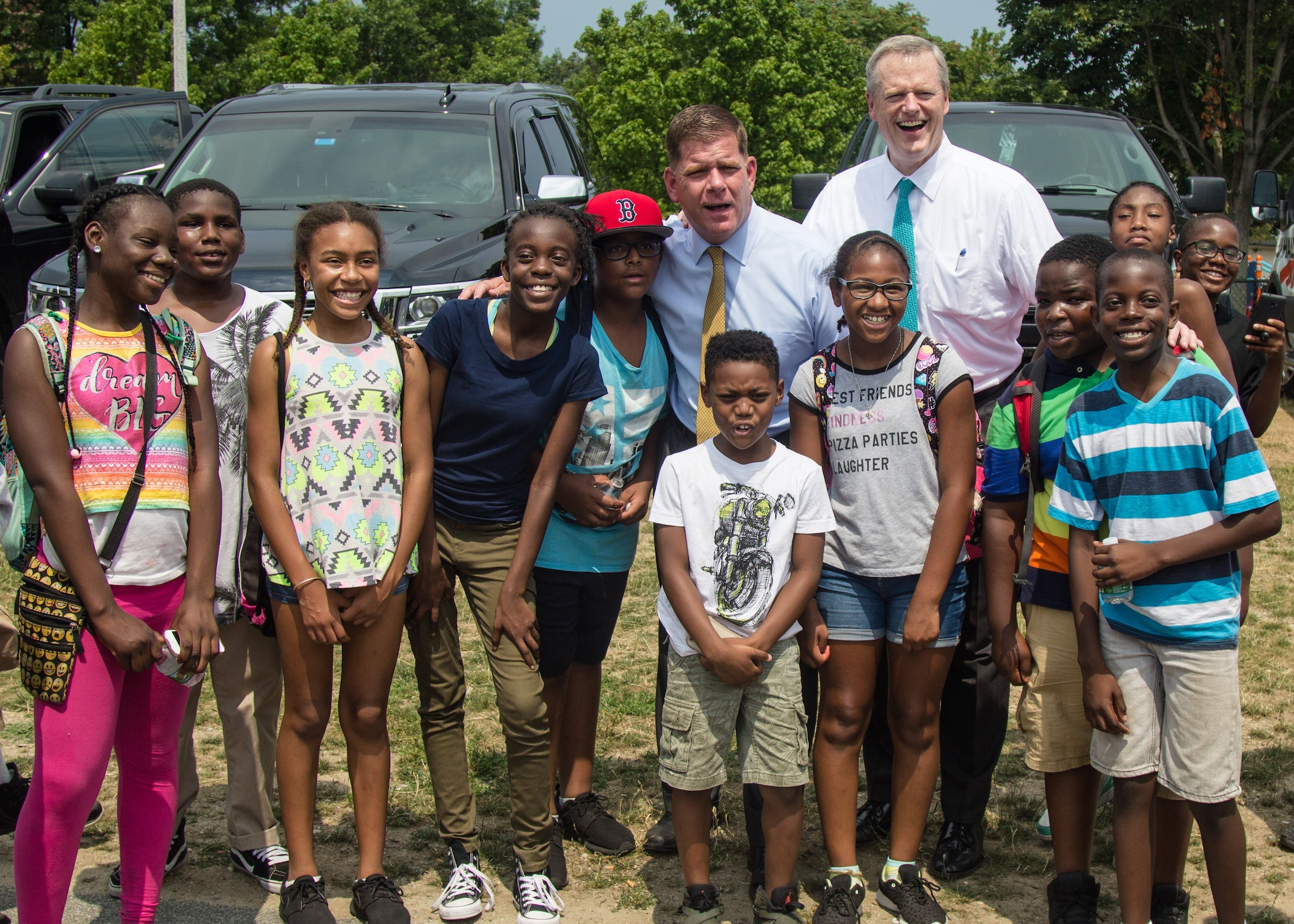 Governor Baker and Mayor Walsh with local children at the Summer Nights kickoff.