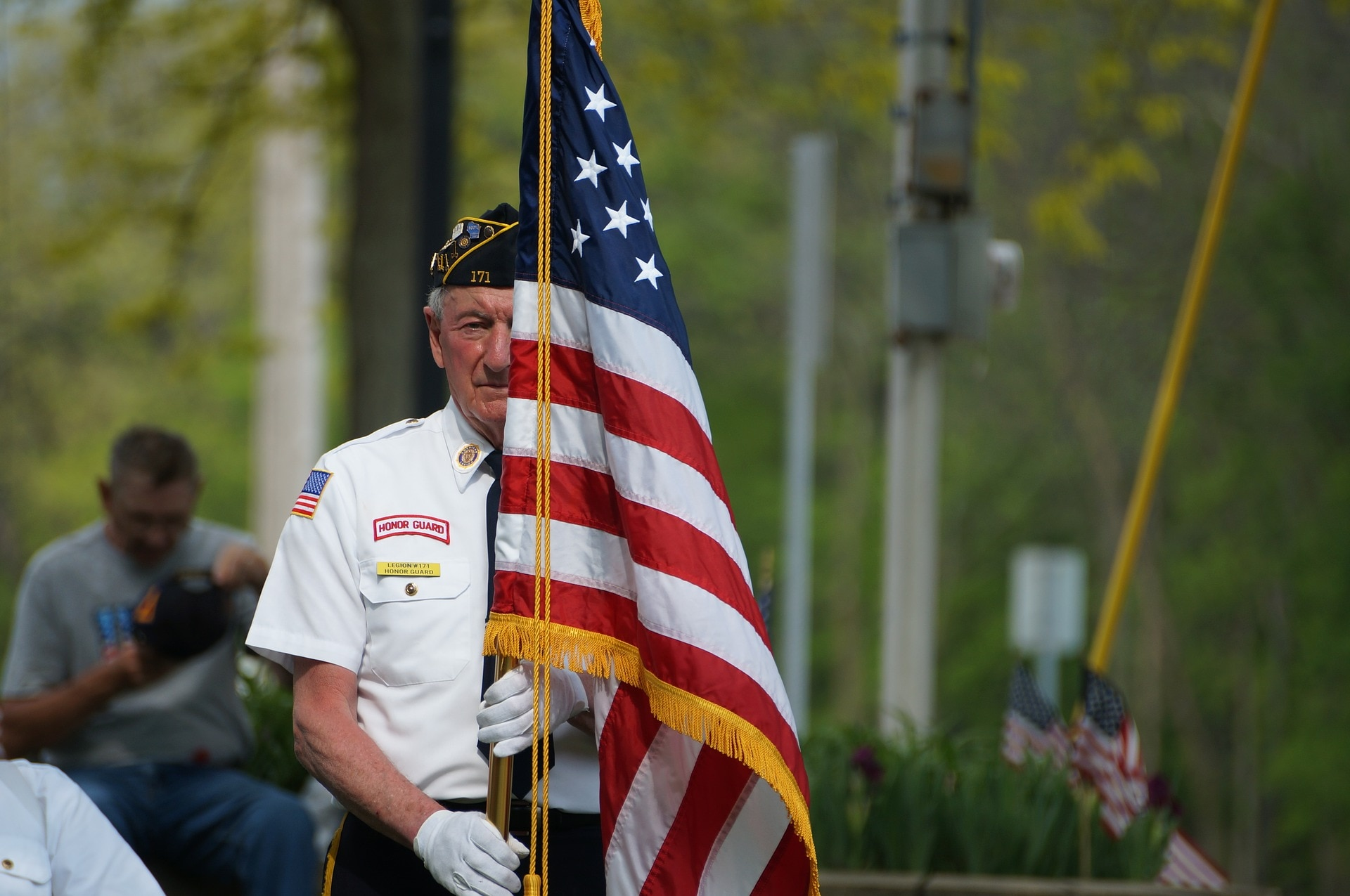 A veteran carrying the United States flag.