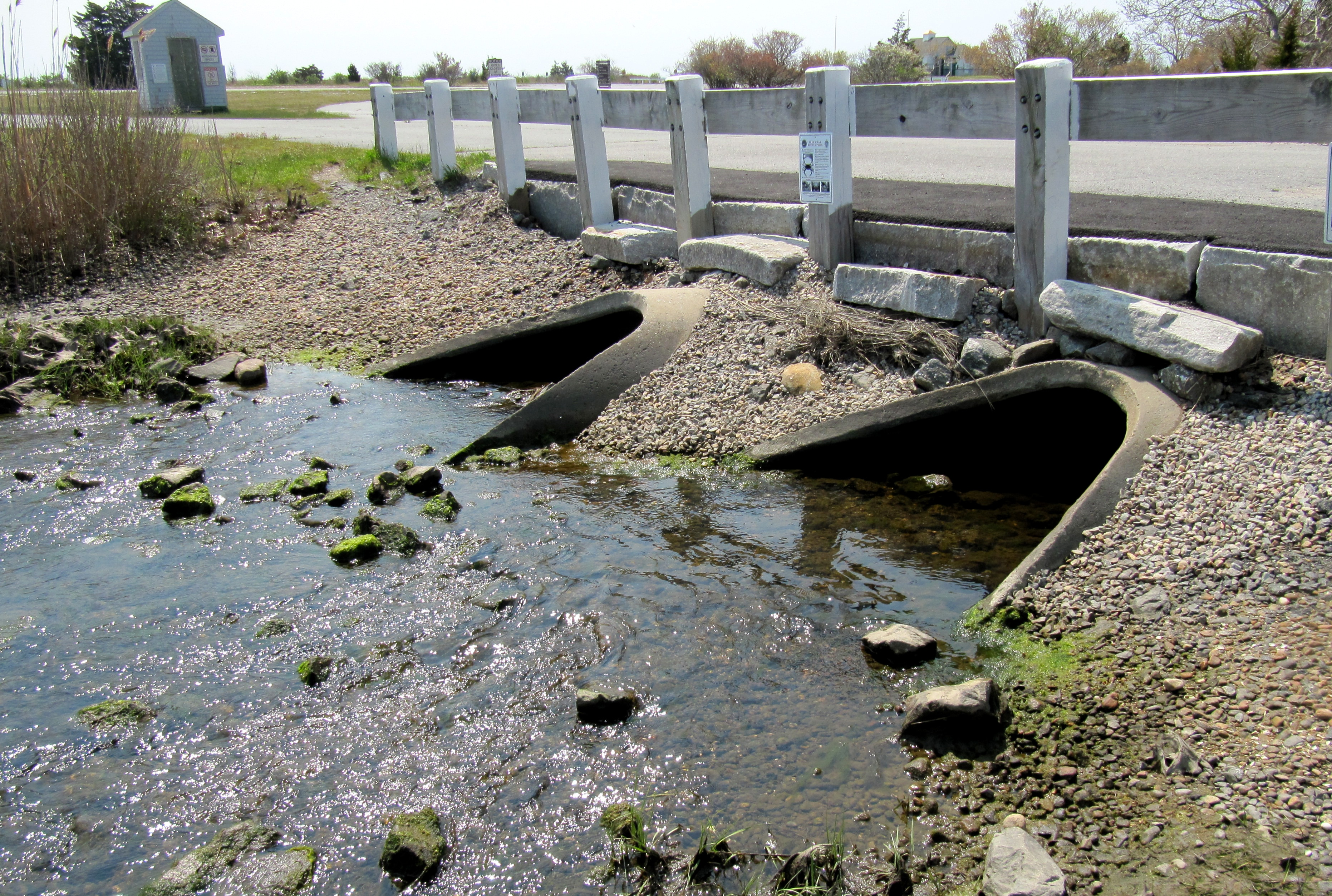 The current crossing and culverts at George's Pond cause a 90% reduction in tidal range.