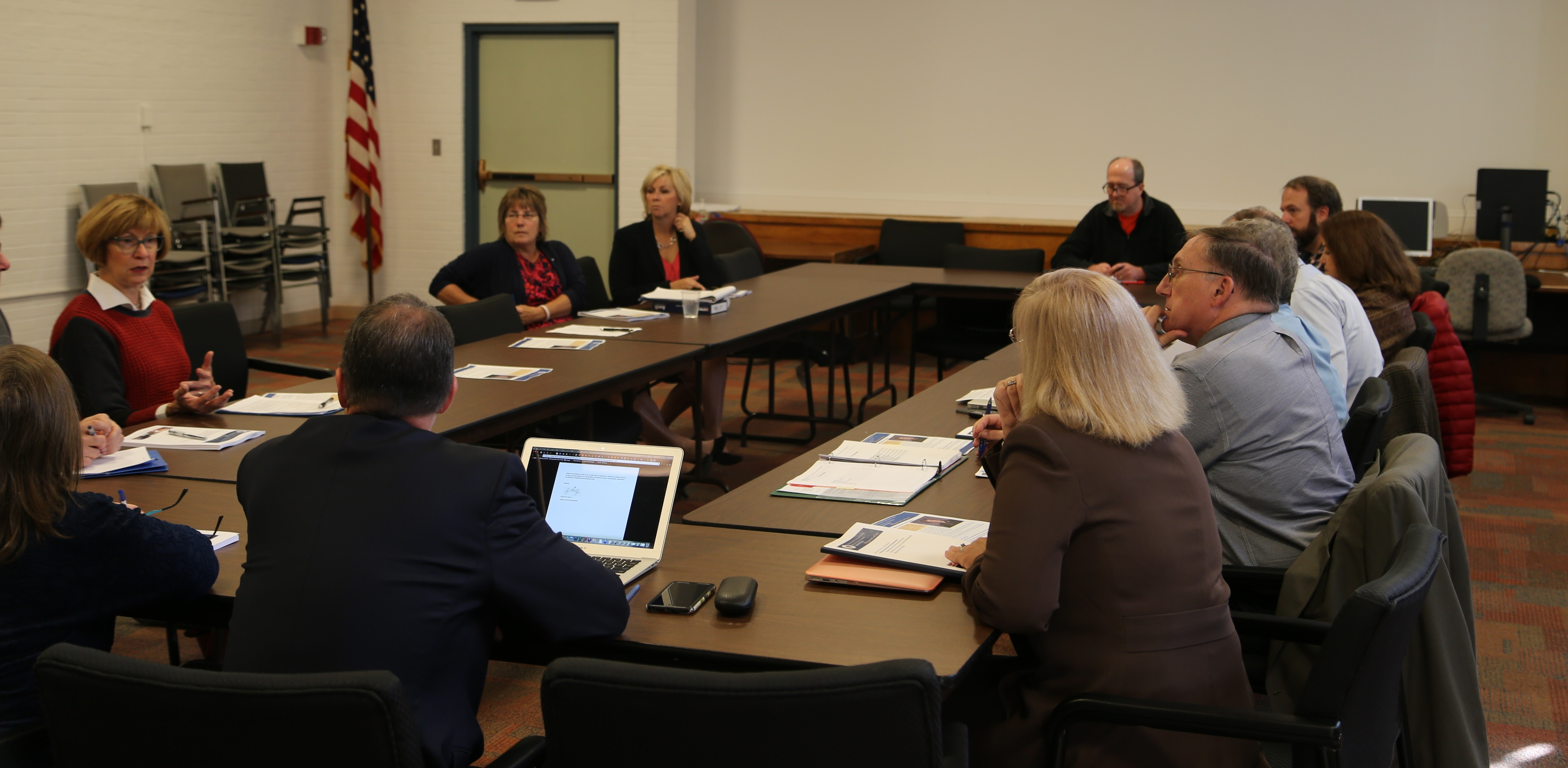 State Auditor Suzanne M. Bump (left) discusses the finding and recommendations contained in her office's analysis of the Massachusetts regional school district structure with representatives from the Wachusett Regional School District.