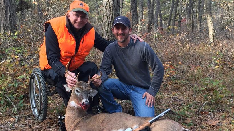 Paraplegic deer hunter with MassWildlife staff and deer