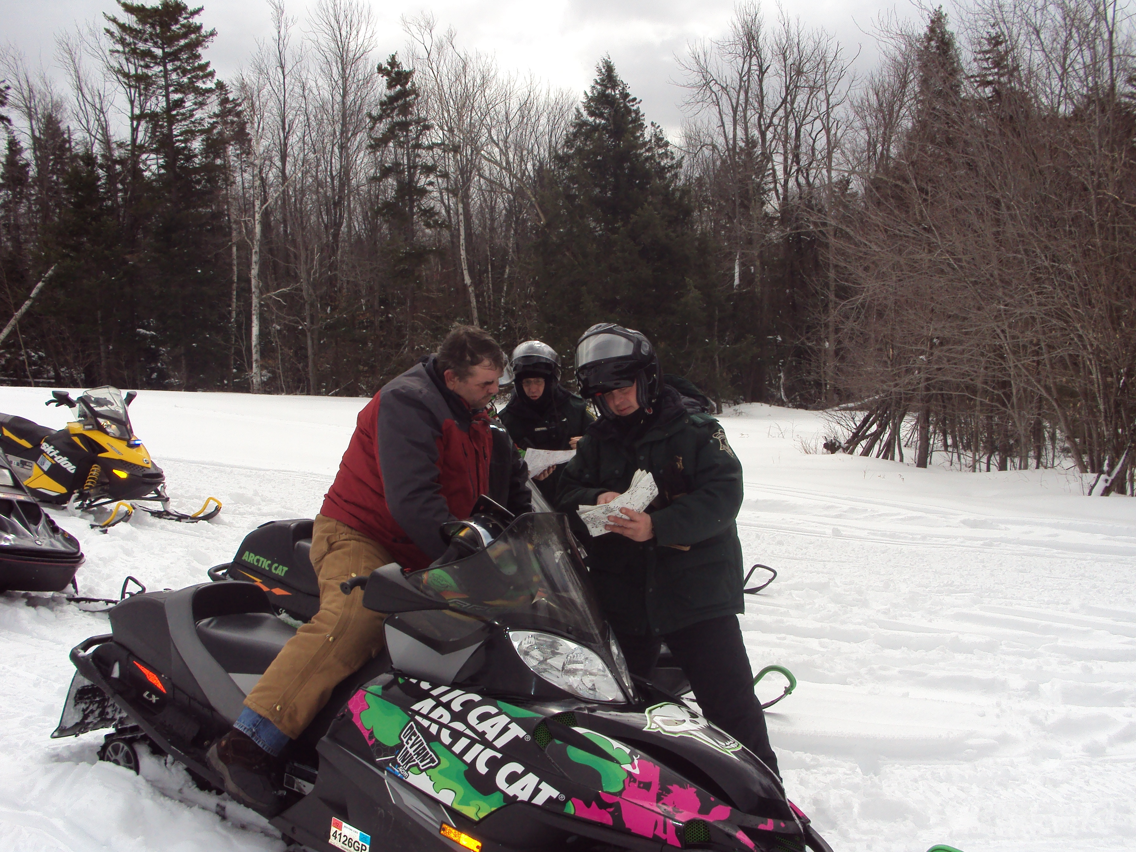 Environmental Police Officer explaining the Snowmobile Safety Laws