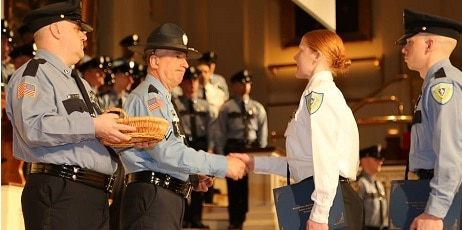 Massachusetts Correctional Officer shaking hands in the graduation