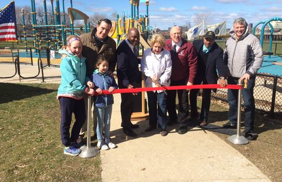 Massachusetts Department of Conservation and Recreation Commissioner Leo Roy and state and local officials celebrate the opening of the Mary O'Malley State Park playground in Chelsea