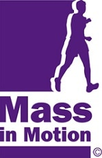 "A purple outline of a person walking with the text ""Mass in Motion"""