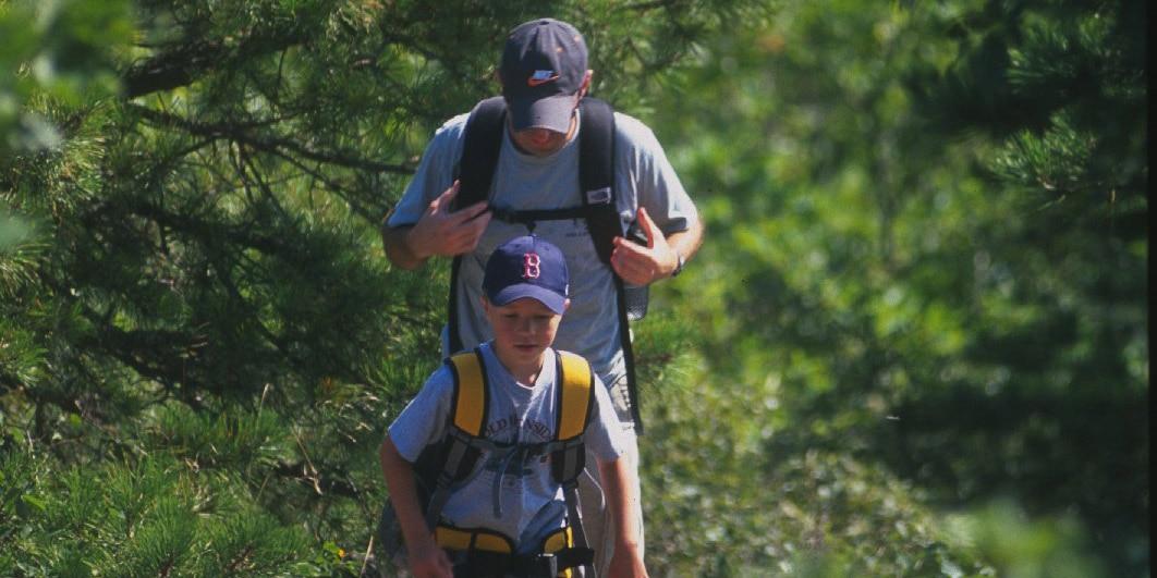 man and boy hiking at blue hills