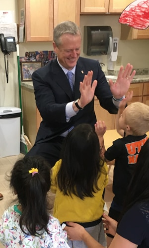 Governor Baker high-fiving children