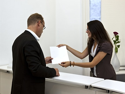 Court employee helping woman with paperwork
