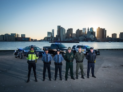 Officers standing in front of vehicles