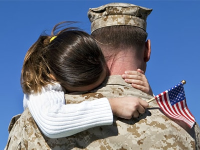 Daughter hugging dad who's returned from active duty