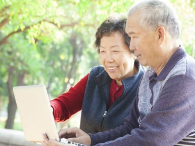 Elderly couple looking at a computer