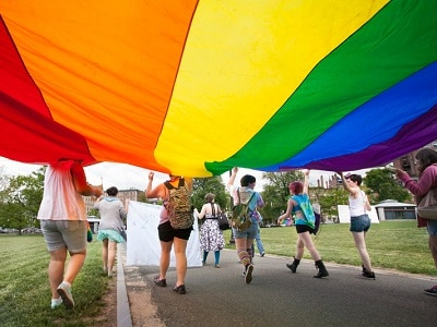 Teens with a rainbow flag.