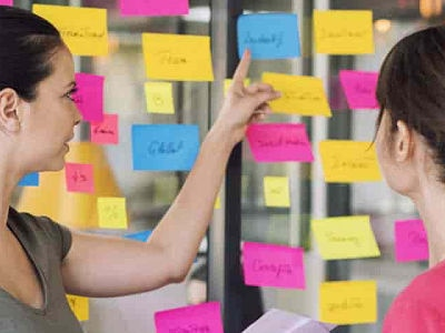 woman pointing to sticky notes
