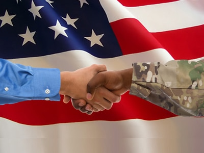 handshake between businessman and soldier