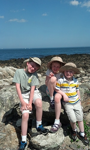 kids on rock at beach