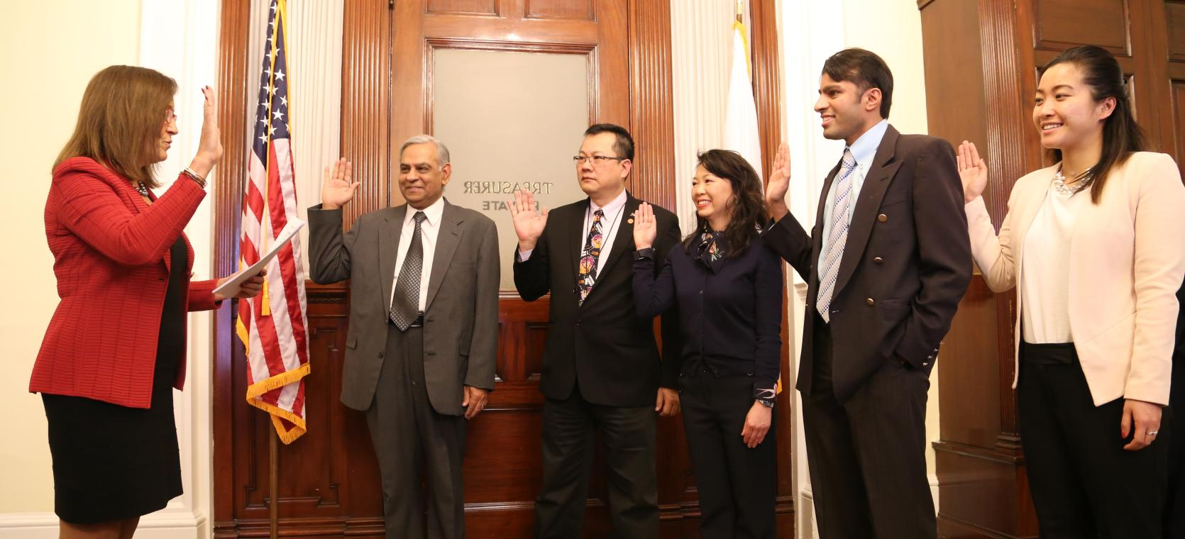 New members of the Asian American Commission were sworn in by State Treasurer Deborah Goldberg in her State House Office. The new commissioners, from left are: Anil Saigal, Gilbert Ho, Loan Dao, Janjy Ananth, and Nina Liang.