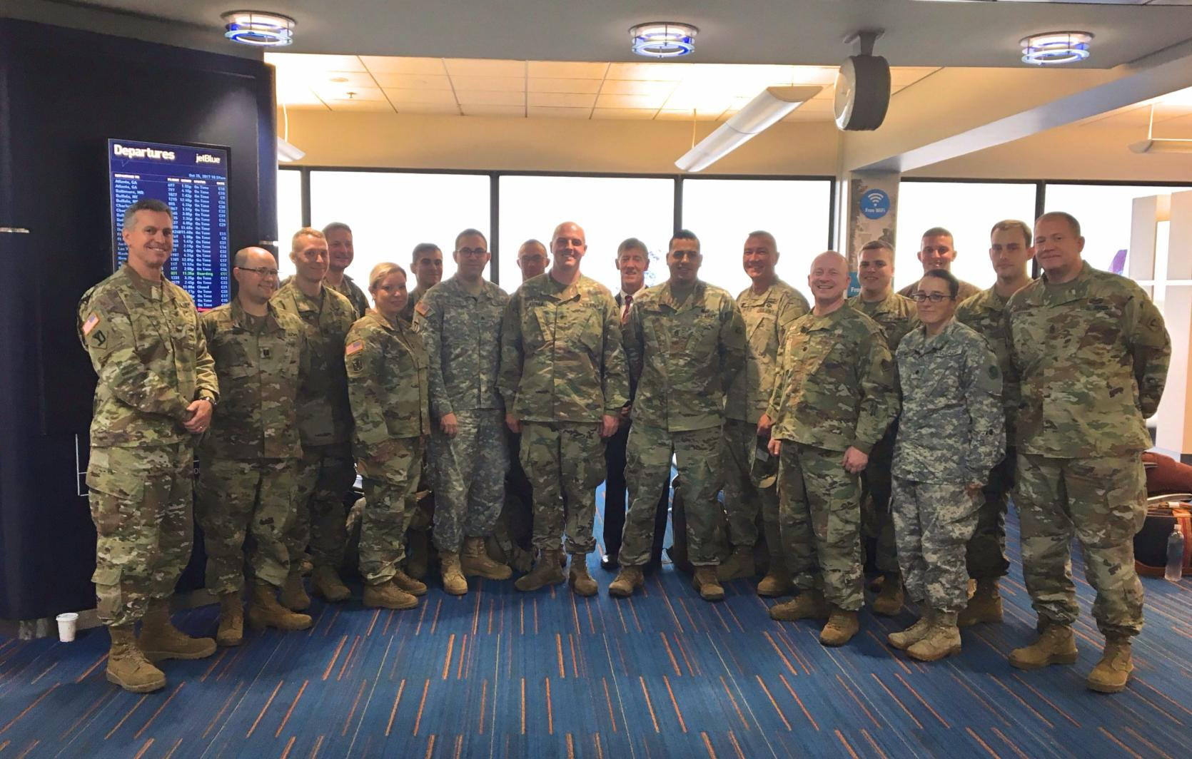 Soldiers from the 65th Press Camp Headquarters, Massachusetts Army National Guard depart Logan Airport for a relief mission to Puerto Rico