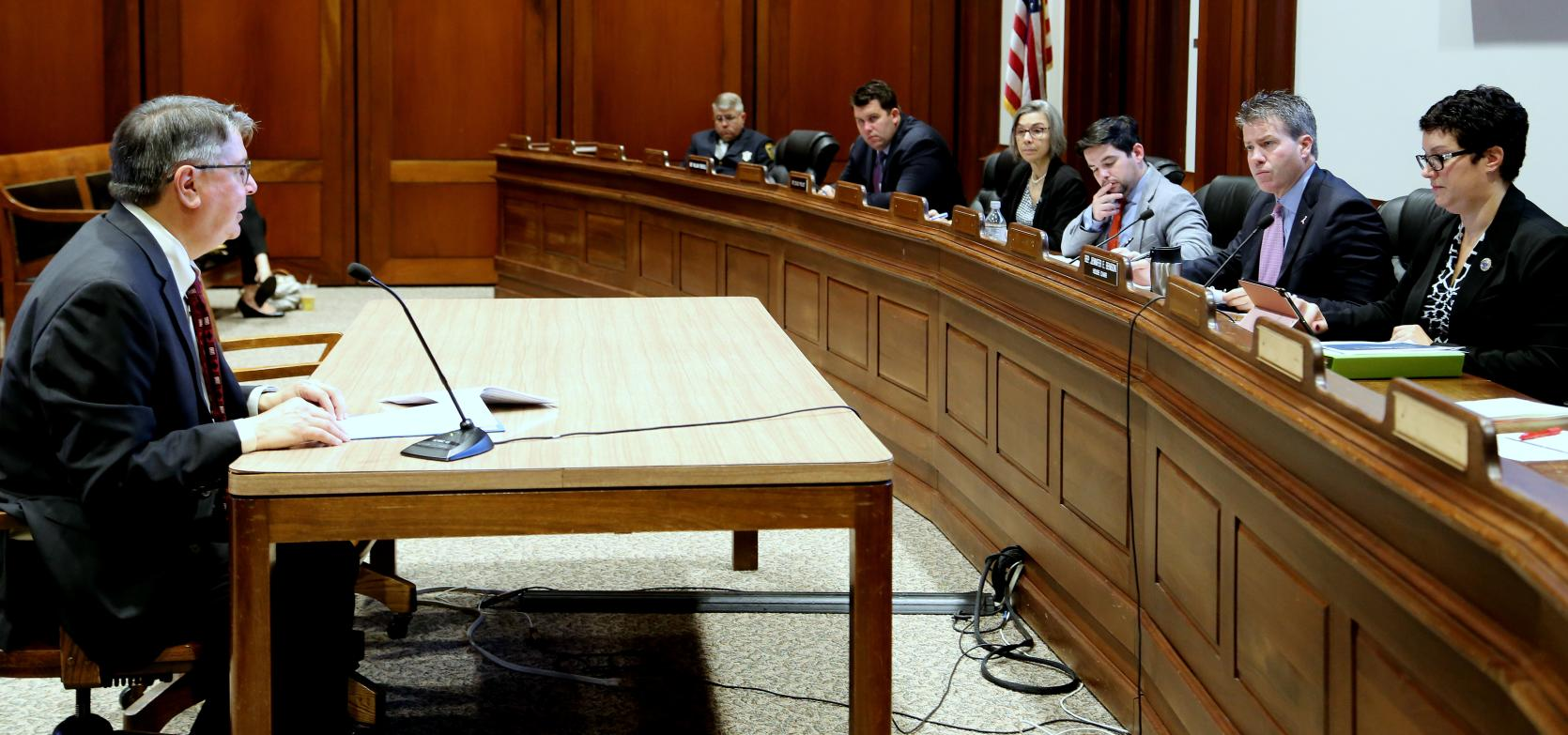DLM Director Ben Tafoya testifies before the Joint Committee on State Administration and Oversight at the State House