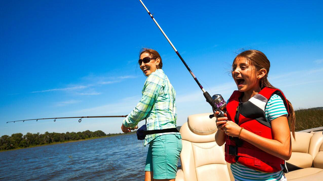 Mother and daughter fishing