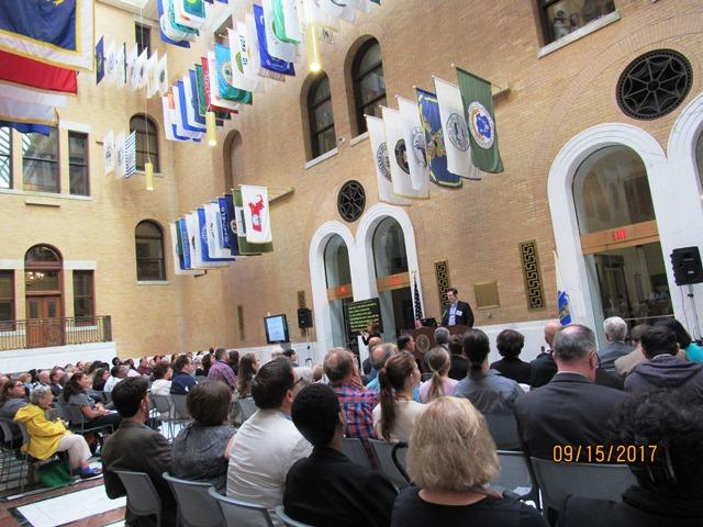 photo of large crowd seated at previous summit, Great Hall of Massachusetts State House