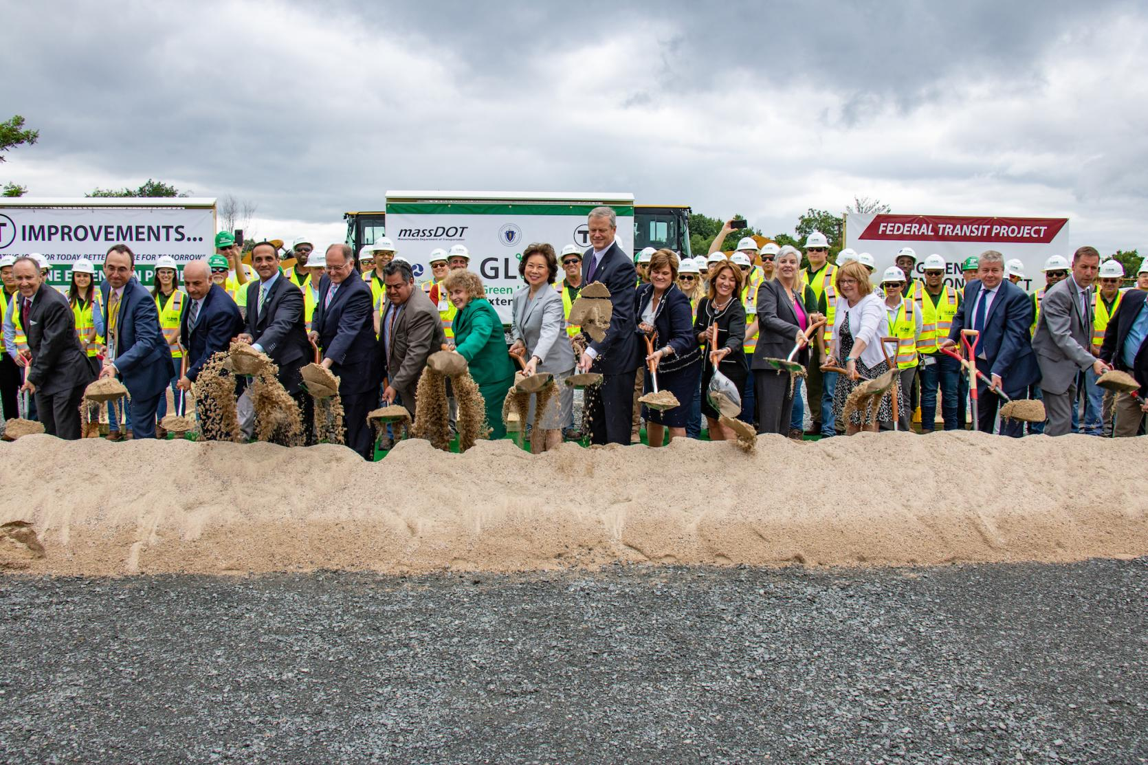 Governor Baker and numerous officials break ground on the Green Line Extension.