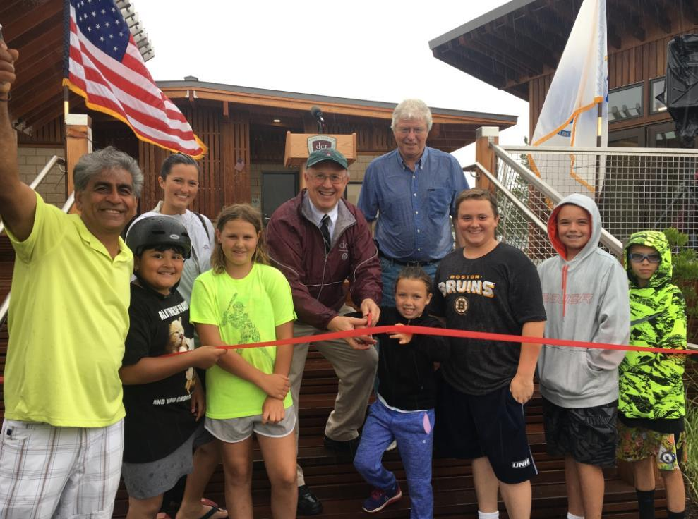Massachusetts Department of Conservation and Recreation Commissioner Leo Roy and others celebrate the opening of the new comfort station at Salisbury Beach State Reservation
