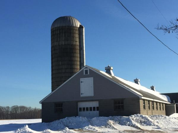 Photo of the barn and silo at Almeida Dairy Farm in Rehobeth, Massachusetts.