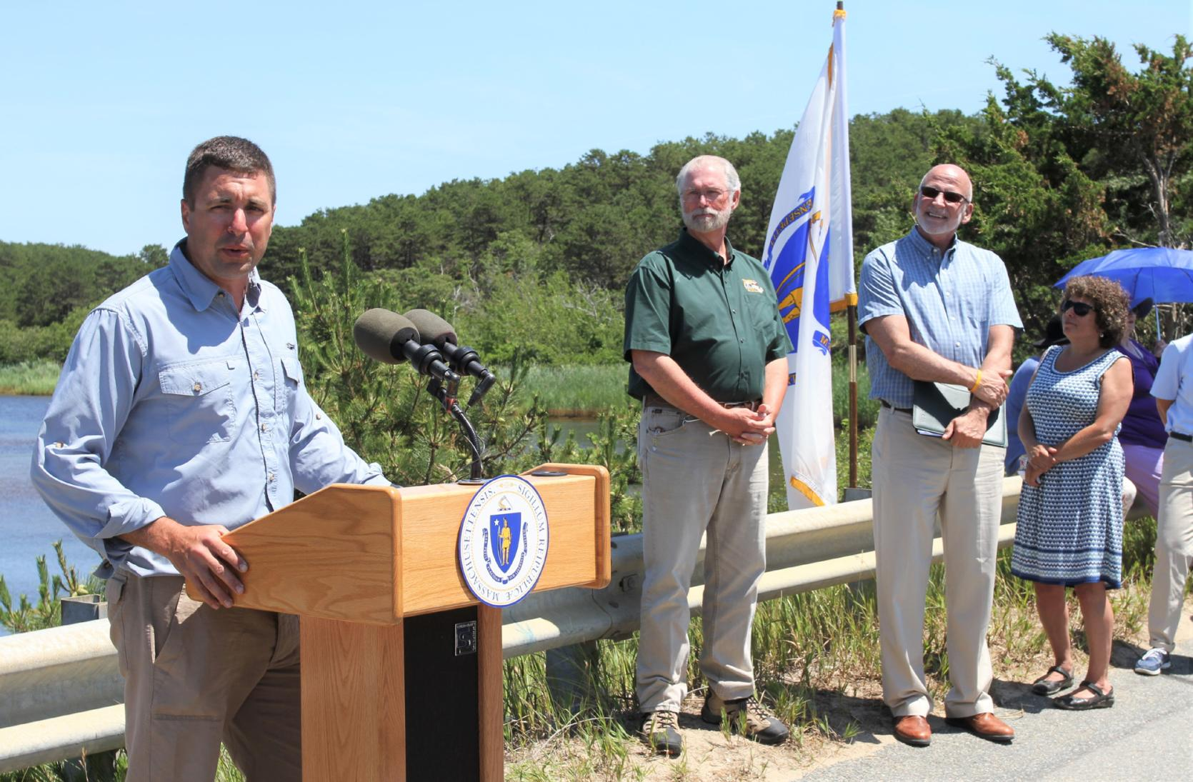 State, federal and local partners gather at the Herring River Estuary Restoration site