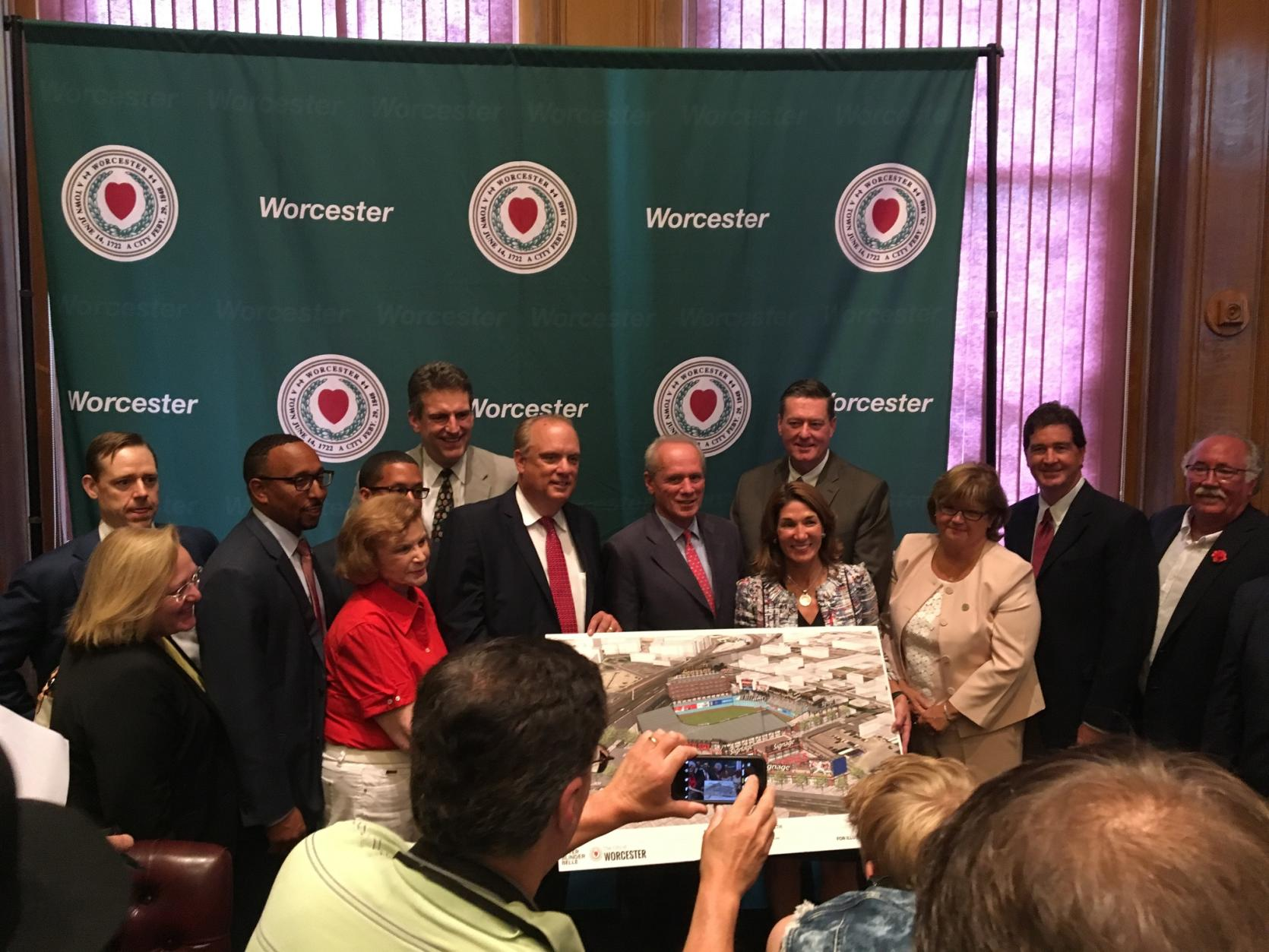 Lt. Governor Karyn Polito and Housing and Economic Development Secretary Jay Ash join state, local and team representatives to unveil a plan that would relocate the Pawtucket Red Sox to Worcester's Canal District.