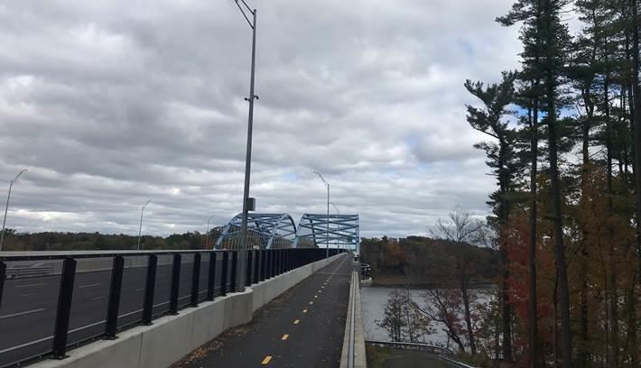 A photograph of the new Whittier Bridge which carries vehicles, bicycles, and pedestrians over the Merrimack River between Newburyport and Amesbury.