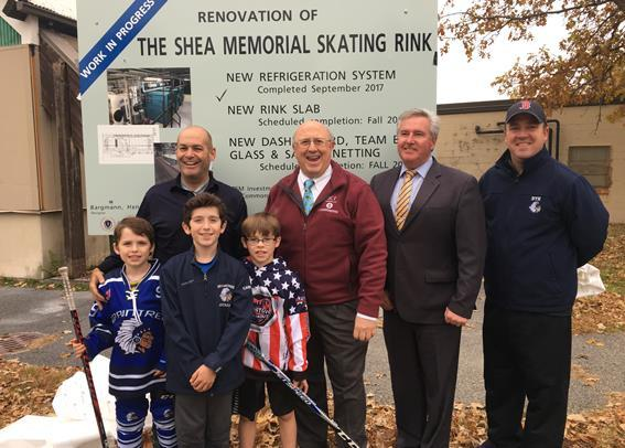 commissioner and others at Shea rink