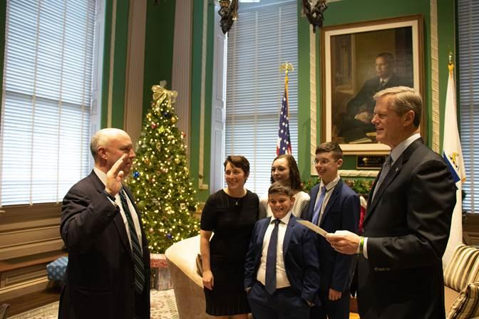 Governor Charlie Baker swears in Secretary Mike Kennealy.