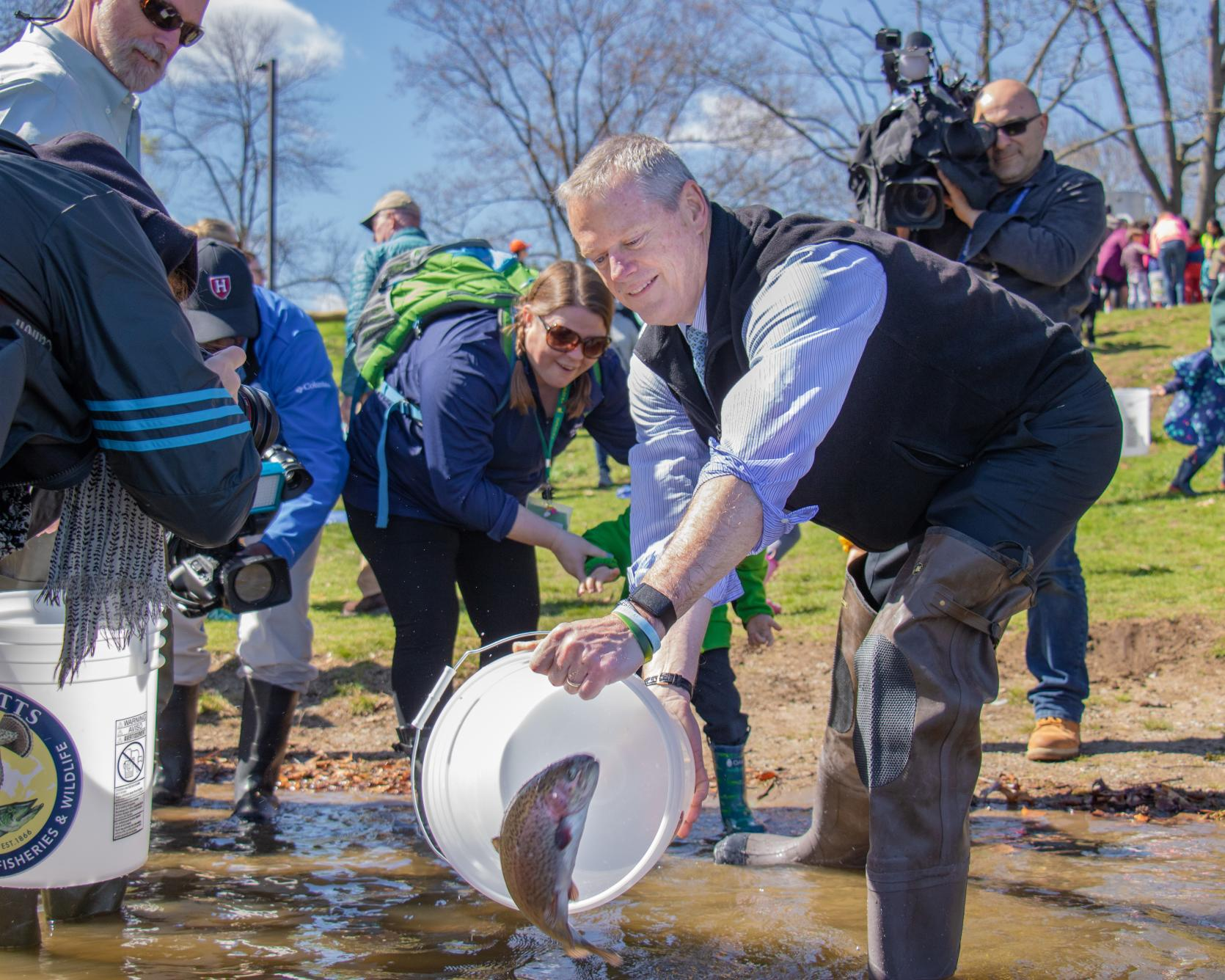 Governor Baker, State Environmental Officials, Local Youth Stock Trout at Boston's Jamaica Pond