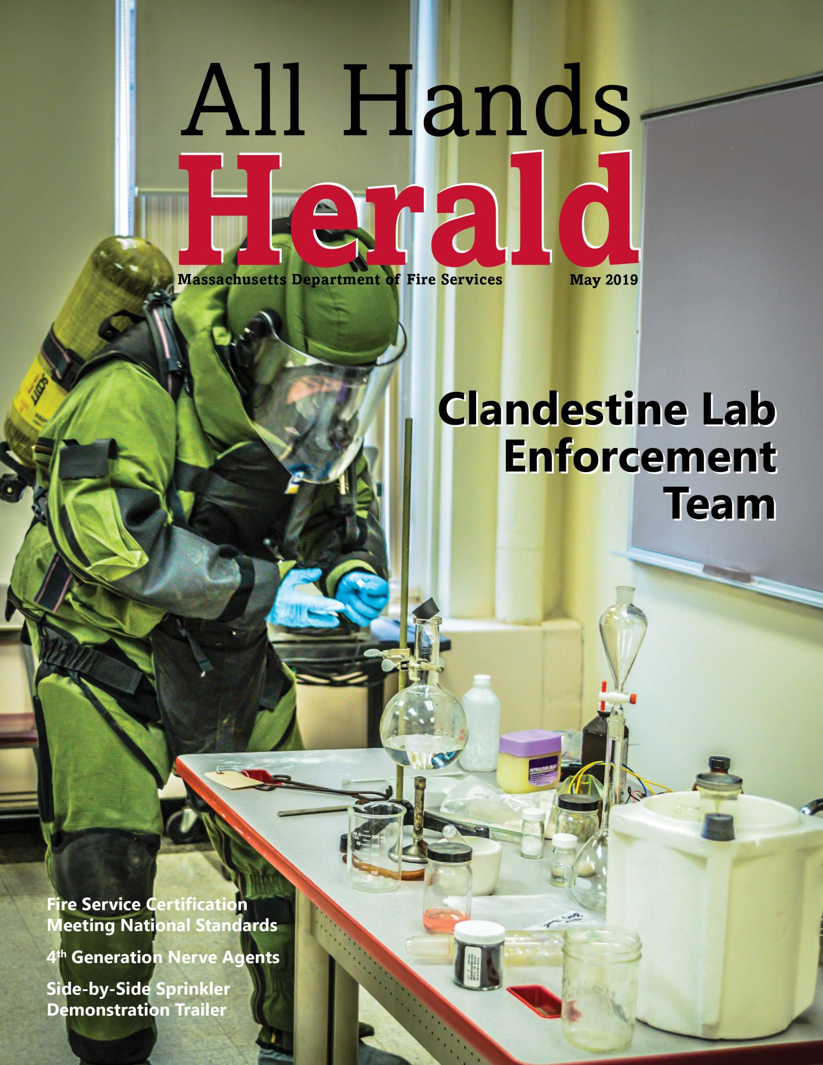 Cover of May 2019 All Hands Herald shows member of CLET in protective gear