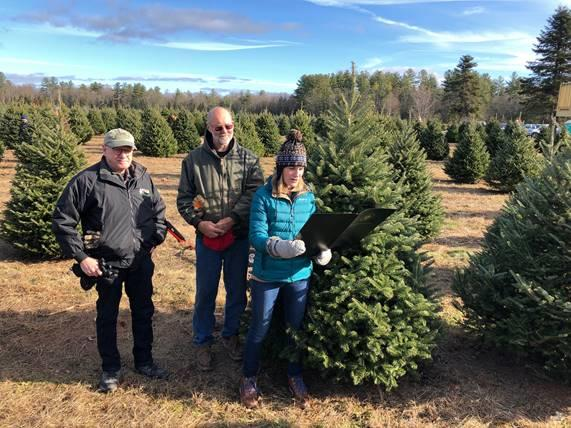 "Secretary Theoharides reads the ""Green Friday"" proclamation at Chestnut Mountain Christmas Tree Farm in Hatfield."