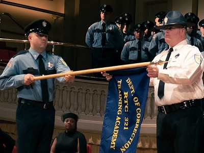 correction officers holding the DOC flag