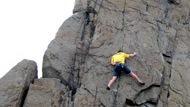 Man rock climbing on cliffside.