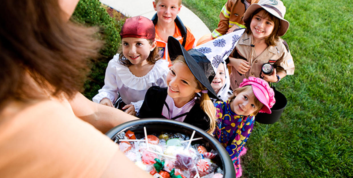 Children trick-or-treating in Halloween costumes