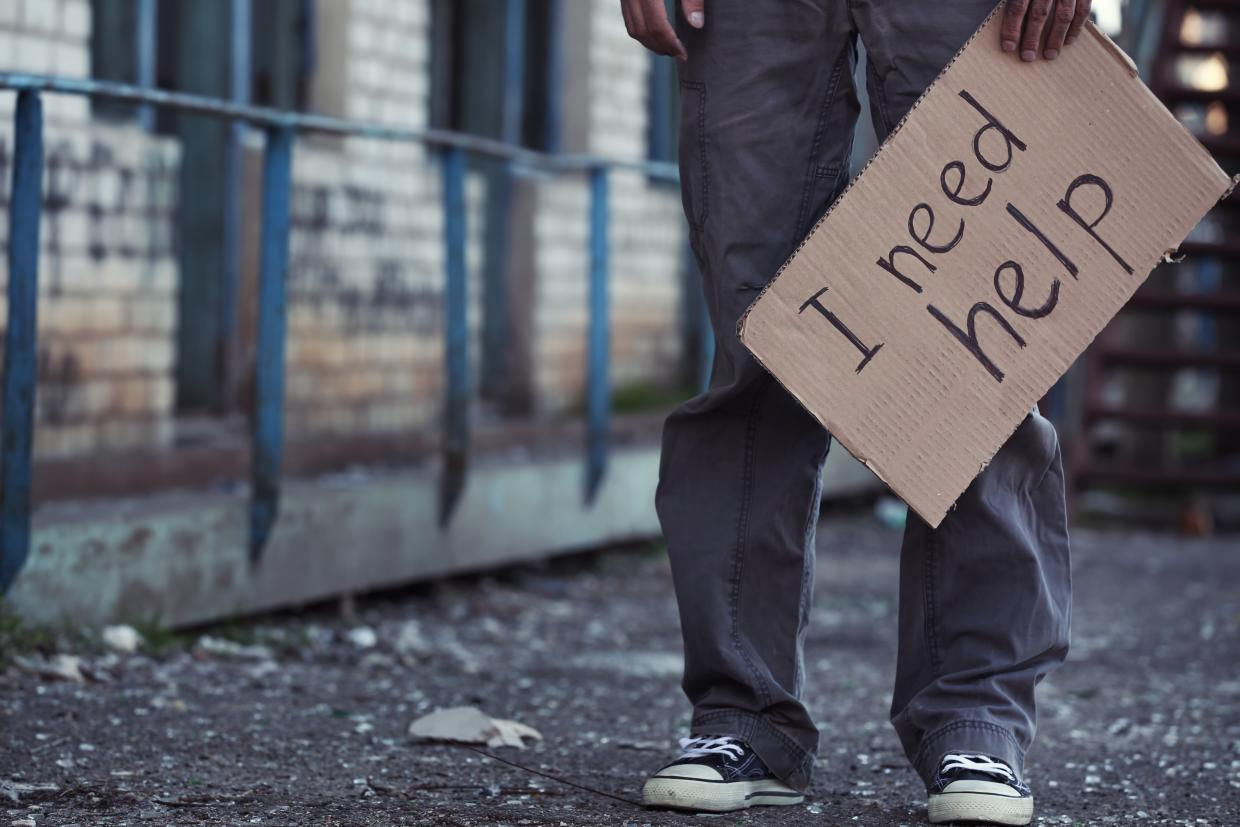picture of homeless youth with sign