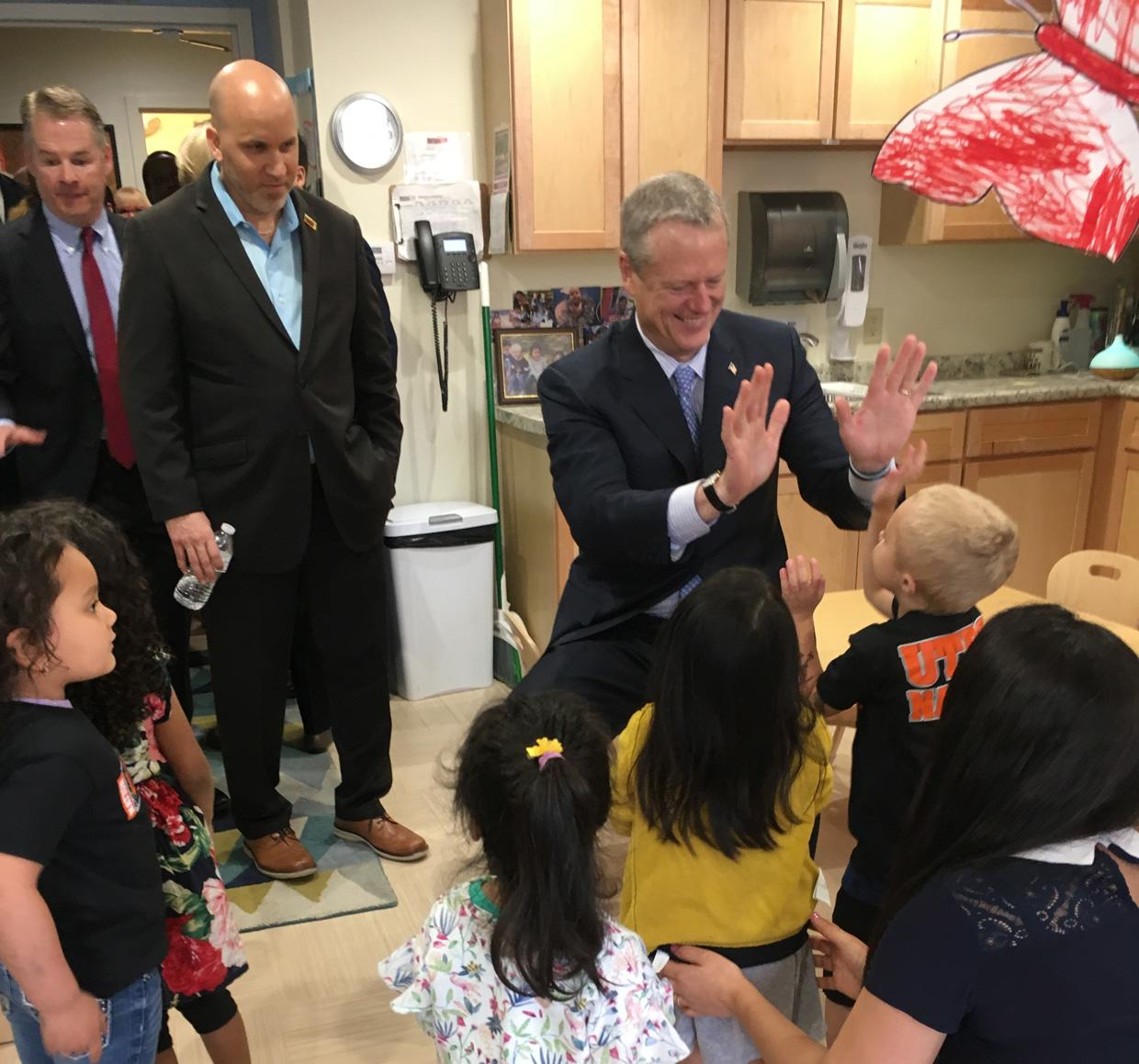 Governor Charlie Baker greets young students