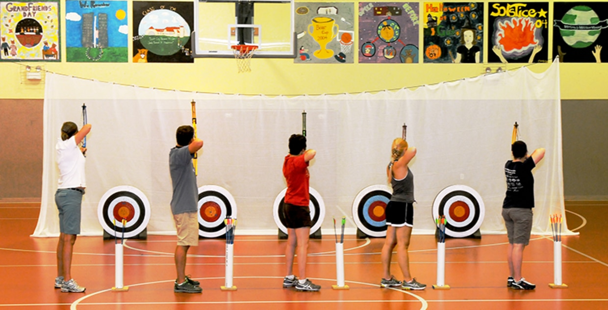 National Archery in the Schools Program. Students taking aim.