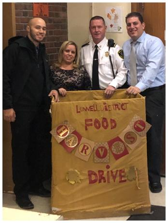 Lowell District Employees with Food Drive Basket