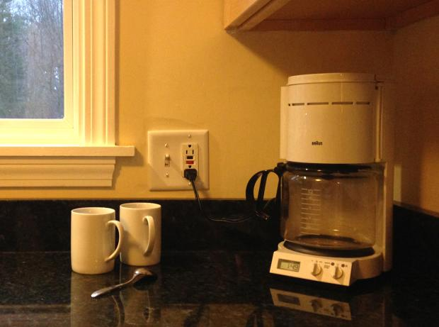 Picture of coffee maker on kitchen counter.
