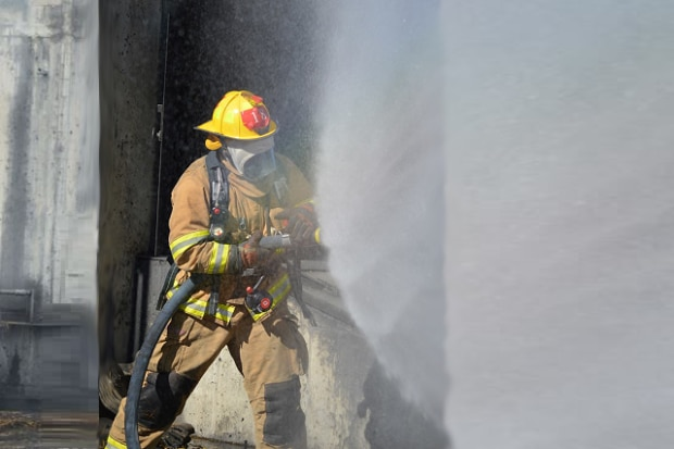 firefighter in training at MAssachusetts Fire Academy