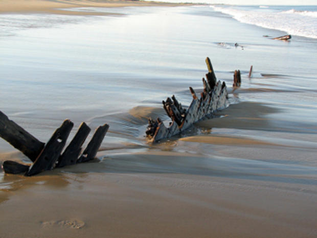 Old ship timbers are sometimes exposed at the beach.