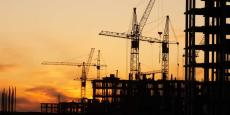 Photo of a construction site at sunset.